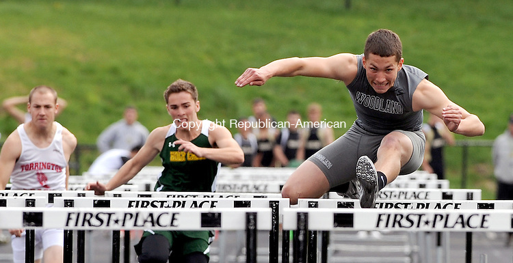 BEACON FALLS,  CT, 28 APRIL  2012-050212JS08- Woodland's Tim Madormo took first in the 110 high hurdles with a time of 15.7 during their meet with Torrington and Holy Cross Tuesday at Woodland High School in Beacon Falls. .Jim Shannon Republican-American
