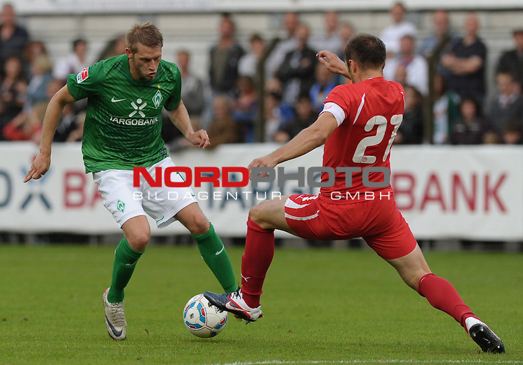 26.07.2011, MEP Arena, Meppen, GER, FSP, Werder Bremen vs Olympiakos Pir&auml;us, im Bild Aaron Hunt (Bremen #14), Avraam Papadopuolos (Piraeus #21)<br /> <br /> // during friendly match Werder Bremen vs Olympiakos Pir&auml;us on 2011/07/26,  MEP Arena, Meppen, Germany.<br /> Foto &copy; nph / Frisch
