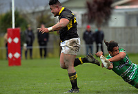 Jeff Makepelu leaps through a tackle during the Mitre 10 Cup preseason rugby match between the Wellington Lions and Manawatu Turbos at Otaki Domain in Otaki, New Zealand on Sunday, 6 August 2017. Photo: Dave Lintott / lintottphoto.co.nz