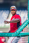 20 September 2013: Washington Nationals bullpen catcher Nilson Robledo tosses batting practice prior to facing the Miami Marlins at Nationals Park in Washington, DC. The Nationals shut out the Marlins 8-0 to take the second game of their 4-game series. Mandatory Credit: Ed Wolfstein Photo *** RAW (NEF) Image File Available ***