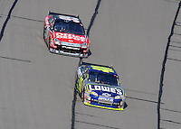 Sept. 28, 2008; Kansas City, KS, USA; Nascar Sprint Cup Series driver Jimmie Johnson (48) leads Carl Edwards (99) during the Camping World RV 400 at Kansas Speedway. Mandatory Credit: Mark J. Rebilas-