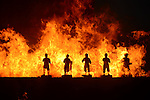 Donggang, Taiwan -- Ornate little figurines are devoured by the flames.
