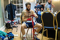 A boxer prepares for his fight at a white collar boxing event at the London Irish Centre where the 'Carpe Diem' boxing event is taking place. <br /> <br /> 'White-collar boxing' is a growing phenomenon amongst well paid office workers and professionals and has seen particular growth in financial centres like London, Hong Kong and Shanghai. It started at a blue-collar gym in Brooklyn in 1988 with a bout between an attorney and an academic and has since spread all over the world. The sport is not regulated by any professional body in the United Kingdom and is therefore potentially dangerous, as was proven by the death of a 32-year-old white-collar boxer at an event in Nottingham in June 2014. The London Irish Centre, amongst other venues, hosts a regular bout called 'Carpe Diem'. At most bouts participants fight to win. Once boxers have completed a few bouts they can participate in 'title fights' where they compete for a replica 'belt'.