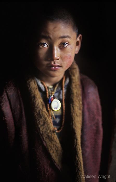 Tibet, Kham<br /> Young monk at Lhonnagon monastery, near Kandze, 2005
