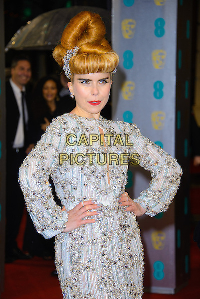 Paloma Faith.EE British Academy Film Awards at The Royal Opera House, London, England 10th February 2013.BAFTA BAFTAS arrivals half length dress white silver grey gray gold beads beaded hands on hips long sleeves cut out away hair up hair up twisted coif quiff   embellished jewel encrusted.CAP/CJ.©Chris Joseph/Capital Pictures