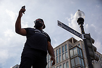 A protester takes a photo in front of the new Black Lives Matter Plaza street sign during a march against police brutality and racism in Washington, D.C. on Saturday, June 6, 2020.<br /> Credit: Amanda Andrade-Rhoades / CNP/AdMedia