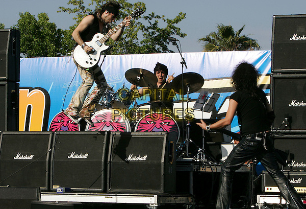 MODERATTO.performs live to a sold out crowd at The Reventon Super Estrella held at The Verizon Wireless Ampitheatre in Irvine, California, USA,  June 02 2007..concert live gig on stage music full length black guitars band.CAP/DVS.©Debbie VanStory/Capital Pictures
