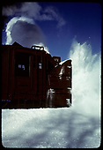 A partial side-view of rotary #OY throwing snow.<br /> C&amp;TS  Chama, NM  prior to 2/1978