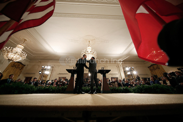 French President Francois Hollande (R) and U.S. President Barack Obama (L) embrace during a joint press conference in the East Room of the White House November 24, 2015 in Washington, DC. Eleven days since coordinated terror attacks left 129 people dead in Paris, Hollande and Obama met in Washington in a show of solidarity and to continue their coordination in the military campaign against the Islamic State, or ISIS, the organization that claimed responsibility for the attacks.  <br /> Credit: Win McNamee / Pool via CNP /MediaPunch