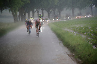 Kris Boeckmans (BEL/Lotto-Soudal) &amp; Kenny Dehaes (BEL/Wanty-Groupe Gobert) fighting their way back to the peloton in a rain storm<br /> <br /> stage 3: Buchten - Buchten (NLD/210km)<br /> 30th Ster ZLM Toer 2016