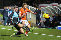 Jason McCarthy of Wycombe Wanderers challenges Craig Mackail-Smith of Luton Town during the Sky Bet League 2 match between Wycombe Wanderers and Luton Town at Adams Park, High Wycombe, England on 6 February 2016. Photo by David Horn.
