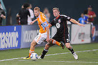 DC United forward Danny Allsopp (9) fights for possession of the ball against Houston Dynamo defender Andrew Hainault (31)    The Houston Dynamo defeated DC United 3-1, at RFK Stadium, Saturday September 25, 2010.