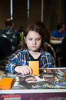Dylan Rogers, 10, long hair, from Columbia, MD ponders his next move. <br /> <br /> <br /> Danny Ghitis for Bloomberg Businessweek