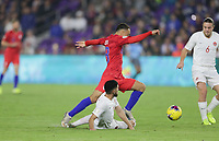 ORLANDO, FL - NOVEMBER 15: Sergino Dest #18 of the United States moves past Jonathan Osorio #21 of Canada during a game between Canada and USMNT at Exploria Stadium on November 15, 2019 in Orlando, Florida.