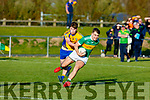 Shane O'Connor of John Mitchells trying to get a way from Beauforts Darragh Coffey in the County Football league game on Saturday.