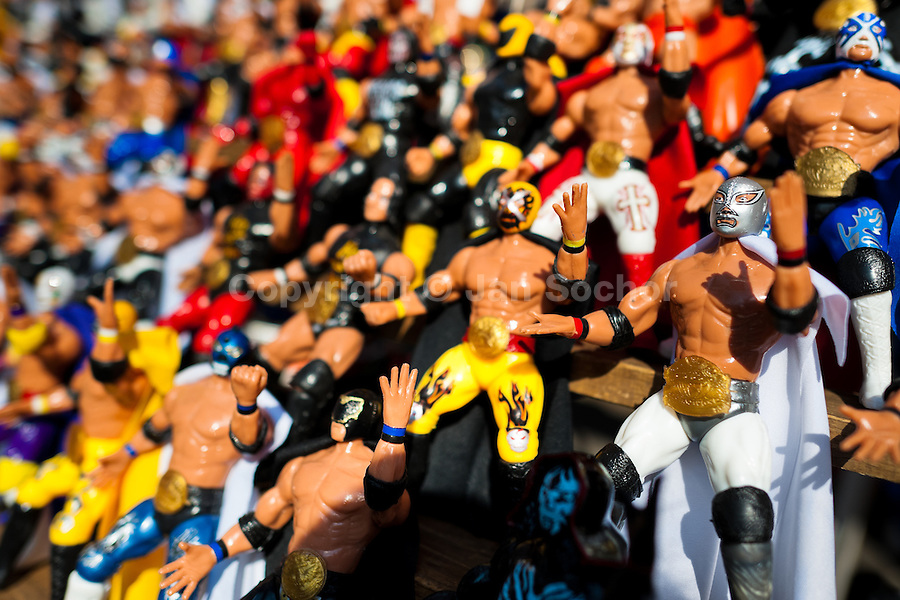 Colorful figures of the Lucha libre (Mexican wrestling) wrestlers for sale in a street shop in Mexico City, Mexico, 29 May 2011. Lucha Libre, 'free wrestling', is a unique Mexican sporting event characterized by the use of colorful masks. Masks (máscaras) have been a part of Lucha Libre since its inception in the early 20th century. The use of the masks in wrestling is related to the Aztec civilization and culture. In modern lucha libre, masks play an important part of the fight storyline, they are colorfully designed to evoke the images of animals, gods, ancient heroes, and other archetypes, whose identity the wrestler takes on during the fight.