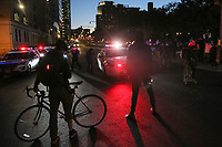 NEW YORK, NEW YORK - MAY 31: Protesters next to police cars on May 31, 2020 in New York. Protests spread across the country in at least 30 cities in the United States. USA For the death of unarmed black man George Floyd at the hands of a police officer, this is the latest death in a series of police deaths of black Americans (Photo by Pablo Monsalve / VIEWpress via Getty Images)