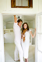 Young couple standing together in doorway