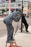 Robbie Beniuk, human statue, street performer, Yonge Dundas, Toronto, Canada, and a young man in repose