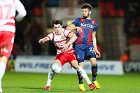 John Marquis of Doncaster Rovers and Nathaniel Knight Percival of Bradford City during the Sky Bet League 1 match between Doncaster Rovers and Bradford City at the Keepmoat Stadium, Doncaster, England on 19 March 2018. Photo by Thomas Gadd.