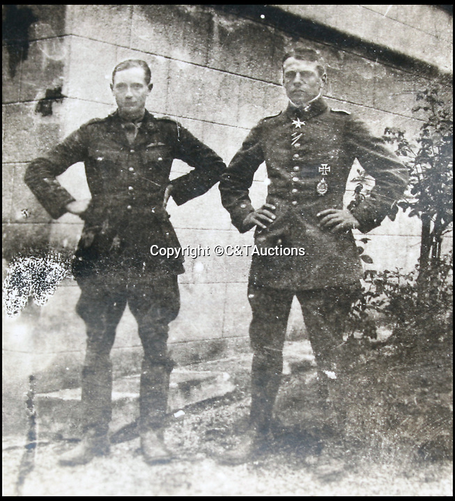 BNPS.co.uk (01202 558833)<br /> Pic: C&TAuctions/BNPS<br /> <br /> Oswald Boelcke(right), a legendary German air ace stood next to Robert Wilson captain of the 32 Squadron Royal Flying Corps.<br /> <br /> A photograph of a German pilot with a British flyer he had shot down before they went off for coffee together has emerged to highlight the remarkable chivalry that existed between the rival air forces in the First World War.<br /> <br /> Captain Oswald Boelcke, a legendary air ace regarded as the father of the German fighter air force, is stood next to Capt Robert Wilson, who had to beat out the flames on his legs and arms after being forced to crash-land his bi-plane behind enemy lines in 1916.<br /> <br /> The photo has emerged in an album of 105 black and white pictures relating to the First World War.
