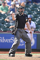 Home plate umpire Brian Hertzog call a strike during the game between the Las Vegas 51s and the Omaha Storm Chasers at Werner Park on August 17, 2014 in Omaha, Nebraska. The Storm Chasers  won 4-0.   (Dennis Hubbard/Four Seam Images)