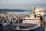 Ships and parked HGVs on quayside at the port of Harwich, Essex, England, UK - foreground Horizon Geobase North Sea supply ship