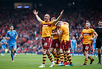 Tom Aldred celebrates with Curtis Main