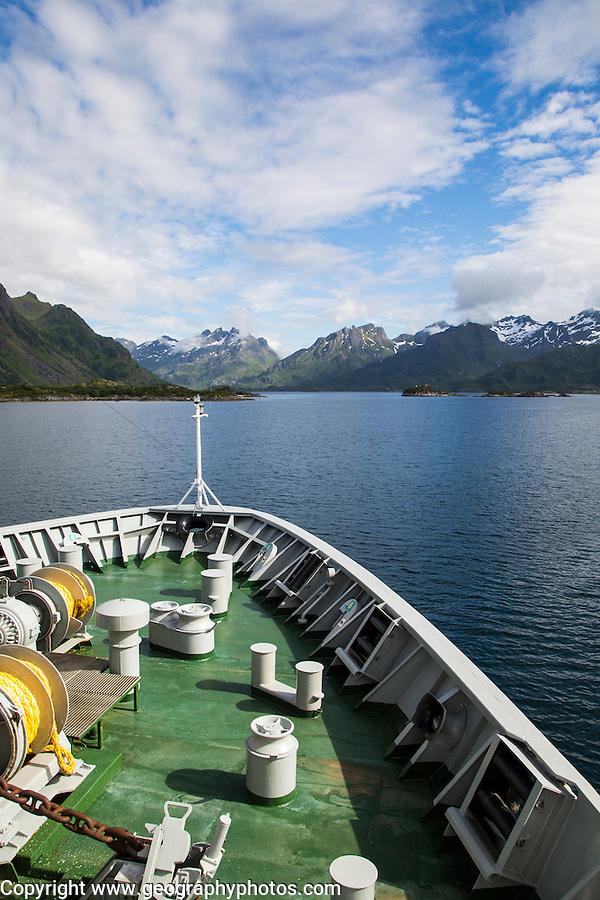 Hurtigruten ferry ship approaching the southern coast of Hinnoya Island, Nordland, northern Norway