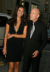 """HOLLYWOOD, CA. - September 24: Emma Heming and Bruce Willis arrive at the Los Angeles premiere of """"Surrogates"""" at the El Capitan Theatre on September 24, 2009 in Hollywood, California."""
