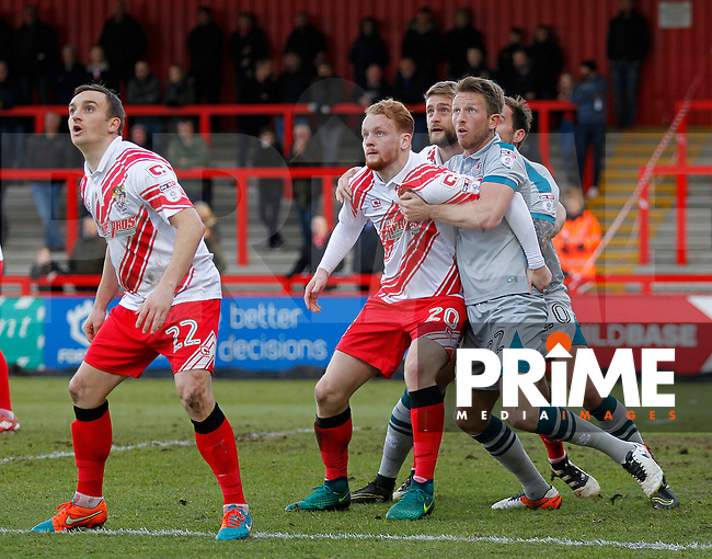 Grimsby's Danny Collins tussles with Stevenage's Connor Ogilvie in the box during the Sky Bet League 2 match between Stevenage and Grimsby Town at the Lamex Stadium, Stevenage, England on 28 January 2017. Photo by Carlton Myrie / PRiME Media Images.