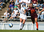 North Carolina's Whitney Engen (9) plays the ball away from Virginia Tech's Erin Moore (22) on Sunday, October 15th, 2006 at Fetzer Field in Chapel Hill, North Carolina. The University of North Carolina Tarheels defeated the Virginia Tech Hokies 1-0 in an Atlantic Coast Conference NCAA Division I Women's Soccer game.