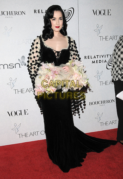 "DITA VON TEESE.Art of Elysium 3rd Annual Black Tie charity gala '""Heaven"" held at 990 Wilshire Blvd in Beverly Hills, California, USA, .January 16th 2010 .full length black maxi velvet pom poms dress pink flowers sleeves velvet beige cream pompoms.CAP/RKE/DVS .©DVS/RockinExposures/Capital Pictures"
