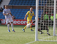 Craig Samson saves from Player/Coach Jim Goodwin in the Kilmarnock v St Mirren Scottish Professional Football League Premiership match played at Rugby Park, Kilmarnock on 13.9.14.