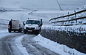08/12/14<br /> <br /> Vans get stuck in the snow on the road over Mam Tor.<br /> <br /> After overnight snowfall in Debyshire dawn reveals stunning snowscapes across the Peak District.<br /> <br /> ***ANY UK EDITORIAL PRINT USE WILL ATTRACT A MINIMUM FEE OF &pound;130. THIS IS STRICTLY A MINIMUM. USUAL SPACE-RATES WILL APPLY TO IMAGES THAT WOULD NORMALLY ATTRACT A HIGHER FEE . PRICE FOR WEB USE WILL BE NEGOTIATED SEPARATELY***<br /> <br /> <br /> All Rights Reserved - F Stop Press. www.fstoppress.com. Tel: +44 (0)1335 300098