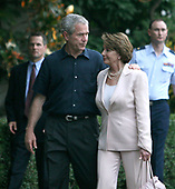 Washington, D.C. - June 19, 2007 -- United States President George W. Bush, left, and Speaker of The United States House of Representatives Nancy Pelosi (Democrat of California), right, chat during the Congressional Picnic on the South Lawn of The White House in Washington DC, Tuesday, June 19, 2007. <br /> Credit: Chris Kleponis - Pool via CNP