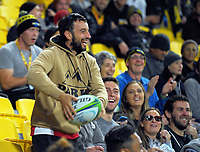 A fan throws the ball back to the pitch during the Super Rugby match between the Hurricanes and Crusaders at Westpac Stadium in Wellington, New Zealand on Saturday, 10 March 2018. Photo: Dave Lintott / lintottphoto.co.nz