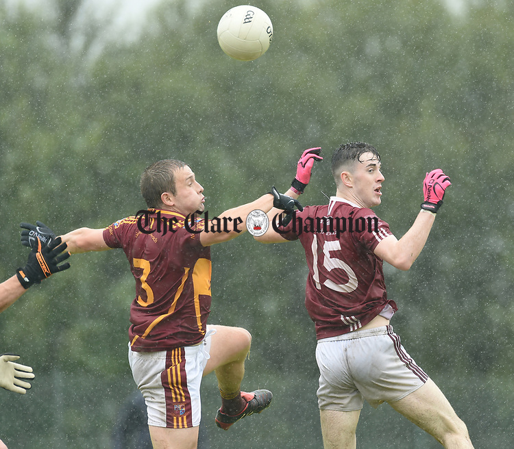 Seanie Malone of St Joseph's Miltown Malbay in action against Joe McGann of St Breckan's during their first round senior championship game in Ennistymon. Photograph by John Kelly