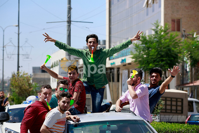 "Palestinian high school students celebrate after heard their results of final exams known as ""Tawjihi"", in the West Bank city of Hebron on July 11, 2016. Photo by Wisam Hashlamoun"
