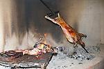 Preparing Sheep Over Open Fire