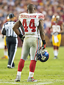 New York Giants running back Ahmad Bradshaw (44) takes a break during an injury time-out in the game against the Washington Redskins at FedEx Field in Landover, Maryland on Monday, December 3, 2012.  The Redskins won the game 17 - 16..Credit: Ron Sachs / CNP