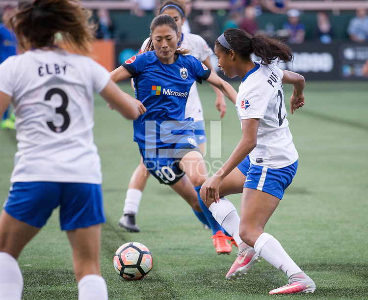 Seattle, WA - Saturday July 15, 2017: Brooke Elby, Rumi Utsugi, Margaret Purce during a regular season National Women's Soccer League (NWSL) match between the Seattle Reign FC and the Boston Breakers at Memorial Stadium.
