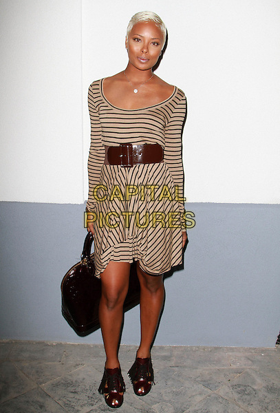 AGYNESS DEYN .UK Style by French Connection Launch Party held at the Lexington Social House, Hollywood, California, USA,.9th March 2011..full length striped cream back brown waist black shoes sandals bag long sleeve .CAP/ADM/KB.©Kevan Brooks/AdMedia/Capital Pictures.