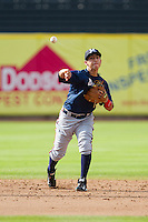 Mississippi Braves shortstop Daniel Castro (20) makes a throw to first base during infield practice prior to the game against the Tennessee Smokies at Smokies Park on July 22, 2014 in Kodak, Tennessee.  The Smokies defeated the Braves 8-7 in 10 innings. (Brian Westerholt/Four Seam Images)