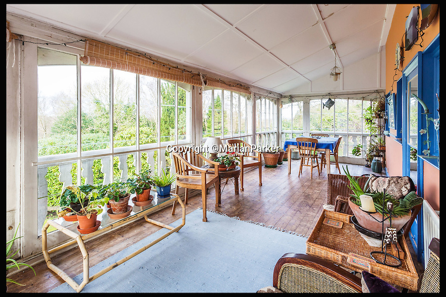 BNPS.co.uk (01202 558833)<br /> Pic: MarianParker/BNPS<br /> <br /> The key design feature of the verandah has now been enclosed to protect owners from the British weather.<br /> <br /> Colonial time capsule - Yours for &pound;1 million.<br /> <br /> The finest original bungalow that remains from Victorian time's is for sale - with a lot more style &amp; grandeur than its hum-drum modern descendents.<br /> <br /> Pleasaunce Cottage in East Grinsted has been meticulously maintained over decades to keep much of its original charm with authentic wood panelling and stained glass windows.<br /> <br /> It is said to be the finest example of a colonial India-style bungalow that exists in this country today and features on the Society for the Protection of Ancient Buildings (SPAB) property list.
