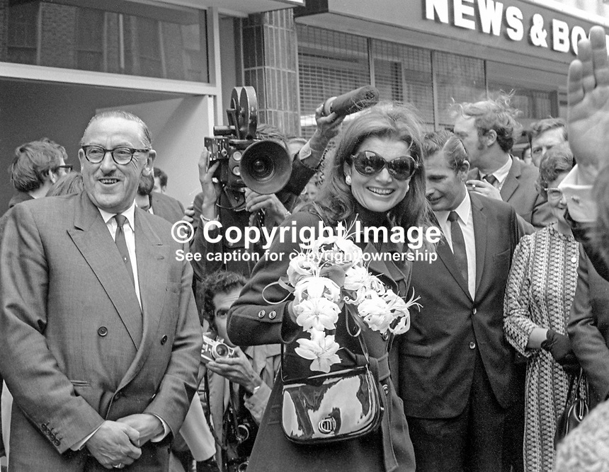 Jackie Kennedy Onassis during a visit to Belfast, N Ireland, UK. She was accompanying her husband, Greek shipping magnate, Aristotle Onassis, to the Harland &amp; Wolff shipyard where he is a 25% shareholder. Jackie is in Queen Street, Belfast where she and husband were entertained to a buffet lunch in the Harland &amp; Wolff Social Club.  197009050347b<br /> Copyright Image from Victor Patterson,<br /> 54 Dorchester Park, <br /> Belfast, UK, BT9 6RJ<br /> <br /> t1: +44 28 9066 1296 (from Rep of Ireland 048 90661296)<br /> t2: +44 28 9002 2446 (from Rep of Ireland 048 9002 2446)<br /> <br /> m: +44 7802 353836<br /> <br /> e: victorpatterson@me.com<br /> www.victorpatterson.com<br /> <br /> Please see my Terms and Conditions of Use at www.victorpatterson.com. It is IMPORTANT that you familiarise yourself with them.<br /> <br /> Images used on the Internet must be visibly watermarked i.e. &copy; Victor Patterson<br /> within the body of the image and copyright metadata must not be deleted. Images <br /> used on the Internet have a size restriction of 4kbs and will be chargeable at current<br />  NUJ rates unless agreed otherwise.<br /> <br /> This image is only available for the use of the download recipient i.e. television station, newspaper, magazine, book publisher, etc, and must not be passed on to any third <br /> party. It is also downloaded on condition that each and every usage is notified within 7 days to victorpatterson@me.com<br /> <br /> The right of Victor Patterson to be identified as the author is asserted in accordance with The Copyright Designs And Patents Act (1988). All moral rights are asserted