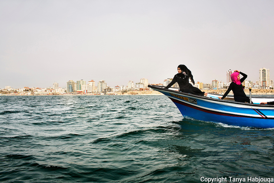 Gaza: High school students in Gaza take a boat ride after grueling examinations before the start of summer break. 2013