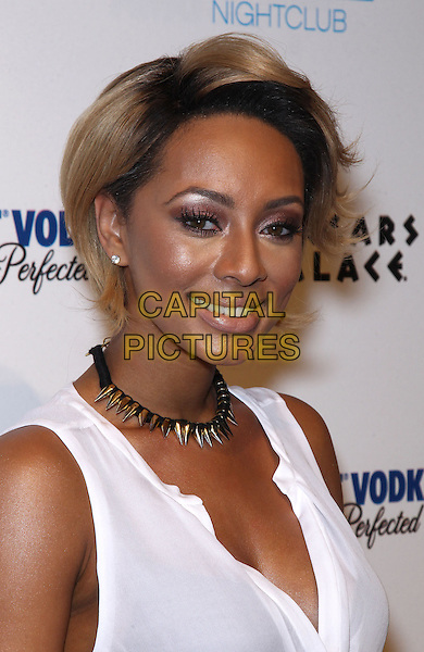 Keri Hilson.Keri Hilson walks the red carpet before performing at Pure Nightclub inside Caesars Palace, Las Vegas, NV, USA, 23rd March 2013..portrait headshot smiling spikes necklace white top shirt sleeveless smiling .CAP/ADM/MJT.© MJT/AdMedia/Capital Pictures.