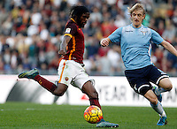Calcio, Serie A: Roma vs Lazio. Roma, stadio Olimpico, 8 novembre 2015.<br /> Roma's Gervinho, left, prepares to kick to score as Lazio's Dusan Basta tries to stop him during the Italian Serie A football match between Roma and Lazio at Rome's Olympic stadium, 8 November 2015.<br /> UPDATE IMAGES PRESS/Isabella Bonotto