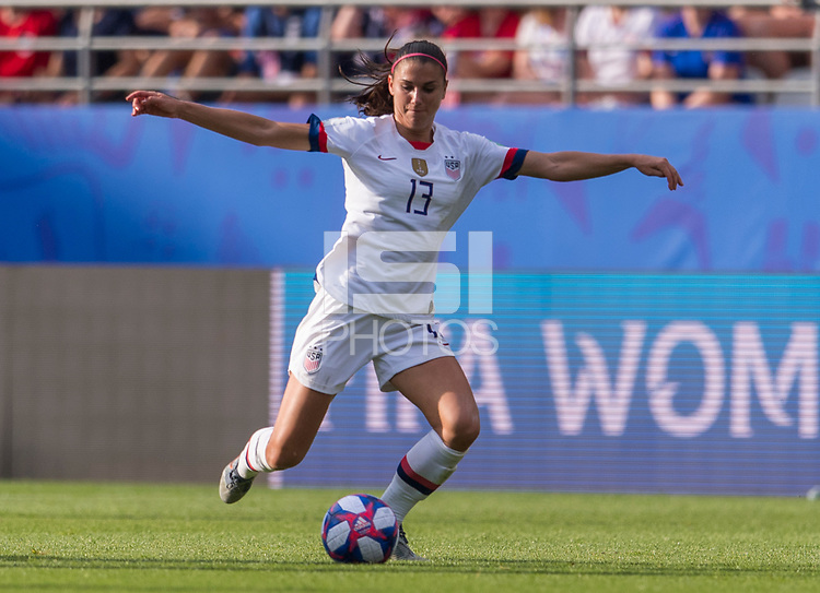 REIMS,  - JUNE 24: Alex Morgan #13 passes the ball during a game between NT v Spain and  at Stade Auguste Delaune on June 24, 2019 in Reims, France.